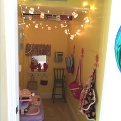 Closet under stairs turned playroom.  So cute.  Love the paper cup light shades!
