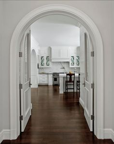 Caden Design Group. Kitchen Ideas. Custom doors that take shape of the arch create a beautiful entrance into a pristine kitchen. #Kitchen