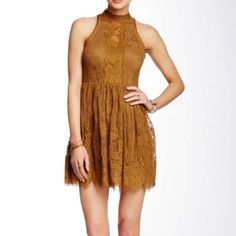 "Free People Lace Mini Dress Golden Color Full skirt. Eyelash lace. Halter neck with button closure. Sleeveless. Lined. Approx 33"" length. Fits true to size. Shell is 60% cotton 40% nylon. Lining is 100% rayon Brand new never been worn!  Size 8 (Medium) Free People Dresses Mini"