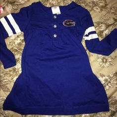 Baby Girl Gator Dress Size 2T long sleeve Gator dress. Super cute but we aren't Gator fans :( Never worn. New without tags. Dresses Long Sleeve