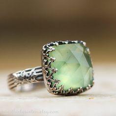 Gorgeous prehnite ring. It glows!