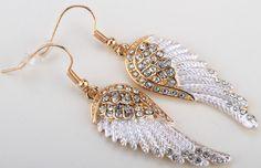 Drop Earrings Item Type: Earrings Fine or Fashion: Fashion Gender: Women Style: Rock Material: Crystal Metals Type: Zinc Alloy Shape\pattern: Feather