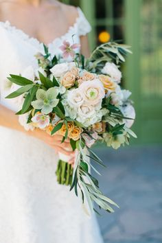 One of my favorite summer wedding bouquets. Peach, lots of greenery, and those unique blooms that deserve a second and third look.   Florist: Dogwood Floral Design  Reception Venue: Willowdale Estate - http://www.willowdaleestate.com  Read More on SMP: http://www.stylemepretty.com/2014/12/29/rustic-elegance-at-willowdale-estate/