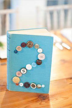 diy button table numbers by Something Vintage Rentals