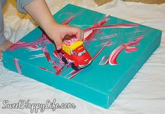 Painting with toy cars - art for her new room!