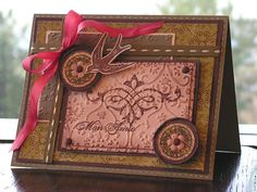 To me this looks like a western, cowgirl card.  Love how unique it is!  SC107 - Mon Amie by rainy - Cards and Paper Crafts at Splitcoaststampers Stamps: Carte Postale Paper: True Thyme, Chocolate Chip, Blush Blossom, DP Ink: Chocolate Chip Accessories: GG Stitched Ribbon, Silk Ribbon, Brads, Primas, Dimensionals, Cuttlebug, Gel Pen, Circle Punches