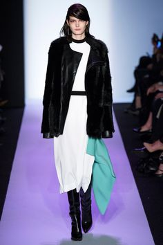 BCBG Max Azria: FUR once again has made its appearance on the fall runway. BCBG Max Azria takes the classic black fur coat and made it their own. They have added a broad shoulders and have tailor the coat to a shorter length than the typical fur coats found today.