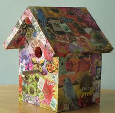 Linda Wiggen Kraft shows you step by step how she made this fun and colorful decoupage bird house. She starts with photos that are cut out in their almost complete form.  Many of the edges will be covered with other photos, so not every photo needs crisp cuts all around. The back and front of each paper cut is covered in glue and layered onto the surface. She finally sprayed all sides and the bottom to protect the papers and to slow down the UV fading.