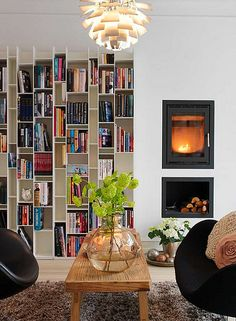 a danish family home.  Book shelves (LOVE) and the fire place.