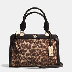 COACH  Madison Mini Lexington Carryall In Ocelot  Print Fabric.  Nice change from the leopard, zebra print fabrics - beautiful.