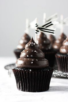 Moist midnight cocoa cupcakes topped with dark chocolate sour cream dream frosting.