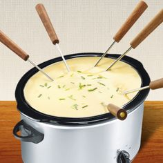 Slow Cooker Cheese-Fondue. Wanna get cooool slow cooker recipes, head up to http://www.slowcookersociety.com
