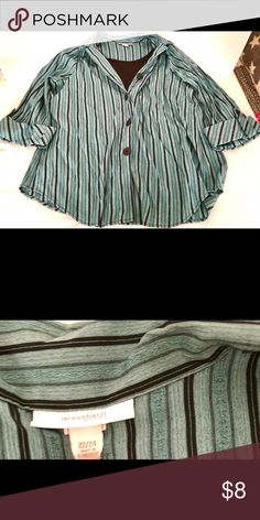 Women's Plus Size two-piece look Top Blouse Here is a women's Plus Sized two piece top made by Dress Barn in a size 22/24. Black insert piece to the top is sewn in and creates a two piece look. Colors are Teal & Black.  Made of  Blouse - 55% Rayon & 45% polyester Tank - 100% polyester.  In great used condition. Dress Barn Tops Blouses