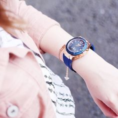 Amy Rebair, fashion blogger shows off her GUESS connect watch.