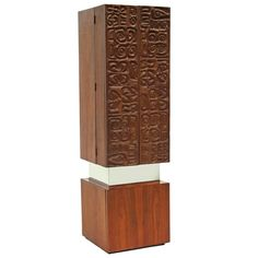 1970s Brutalist Cabinet with a Textured Relief and Chrome Trim   See more antique and modern Cabinets at https://www.1stdibs.com/furniture/storage-case-pieces/cabinets