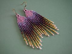 gorgeous shades of lavender and wisteria blend to metallic iris purple then olive greens and gold! a unique look reminiscent of a beautiful lavender garden discovered on a warm summer day. from delicate brass earring hooks, these very lightweight earrings measure just over 3 inches long and