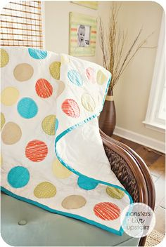 I have toyed with doing a quilt with circles for a long time.  Tutorial here: http://www.bijoulovelydesigns.com/2010/02/circle-quilt-tutorial-part-one-creating.html