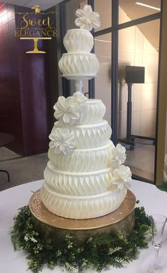 Grand, all white textured wedding cake with modern handmade sugar flowers by Sweet Elegance located in Asheville NC #modernweddingcakes