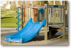 We like this low-level slide which would make play easy-access for children who need extra support