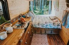 A DIY reclaimed wood van interior that looks AMAZING! Nice details in this van living space and it has the coolest kitchen!