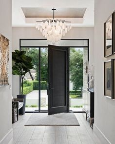 Talk about making an entrance! Loving every single thing about this beautiful light-filled entryway -- the high ceiling and pops of black create such a striking space—and that amazing chandelier is the perfect finishing touch! Sweet Home, Decor Design, Entryway Table Decor, New Homes, House, Beautiful Lights, Entryway Decor, Home Decor, High Ceiling