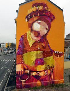 Um novo INTI para Inti MULHOUSE-Lembre-se, a artista de rua chileno? Acaba de lançar uma nova grande muralha em Mulhouse, na Alsácia, França: um de seus distintos personagens com uma tigela de algodão na mão.