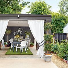 Cabana and Vegetable Garden | An old carport and shed converted into a cabana to create a covered dining area and multipurpose room.