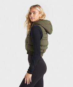 Gymshark Essential Crop Gilet - Khaki   Gymshark Zip Puller, Gym Style, Your Style, Overalls, Essentials, Winter Jackets, Hoodies, Fitness, Model