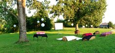 Outdoor movie party hay bale seating.