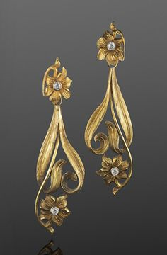 Art Nouveau Yellow Gold and Diamond Flower Motif Pendant Earrings, French, circa 1900  Hand-chased yellow gold flowers and leaves with diamond accents form detachable pendants suspended from floral tops.