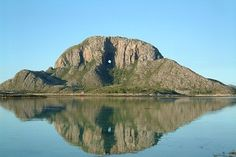 The Torghatten mountain is situated on the island of Torget, Bronnoysund Norway. The legend goes the mountain used to be a hat that belonged to the Troll Torg, hence Torghatten - Torg's Hat Beautiful Norway, The Beautiful Country, Beautiful Places, Amazing Places, Places To Travel, Places To Go, Safari, Norway Travel, Lofoten