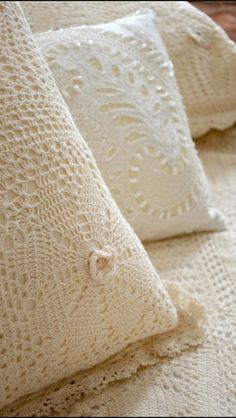 Beautiful off white crocheted bedspread & pillow-cases.