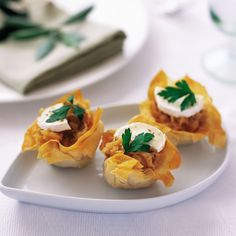 Filo tarts with caramelised onions and goats' cheese are an easy make ahead Christmas starter
