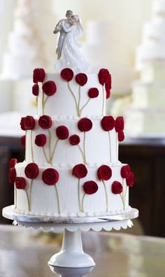 A bouquet of fondant roses makes the perfect wedding cake decoration. Elegant wedding cake. #Flowers #Floral #White #Red. #www.celebritystyleweddings.com @Jason Jones Style Weddings