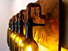Wine Bottle Light Lamp Industrial Vanity Sconce by BSquaredInc Lighted Wine Bottles, Bottle Lights, Glass Bottles, Wine Bottle Crafts, Bottle Art, Wine Bottle Chandelier, Diy Lampe, Deco Originale, Style Deco