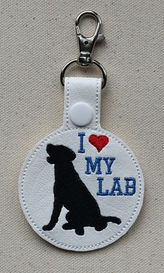 Perfect way to show the love of your favorite Labrador.  Key fob accessory comes with a metal swivel lobster clasp to easily attach to just about anything, including another key set, purse, or a back pack. The I Love My Bloodhound and dog silhouette is embroidered on white marine vinyl with a blank back sewn together giving the key fob a durable finished appeal. The snap at the top of the key fob is a nice feature, allowing you to unsnap it from the key ring.  The complete key ring set…