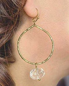 I simply adore these earrings! I have worn them just about every single day since they crossed my desk. Classically simple in style, hammered brass circles (approx. 1 diam.) hang from French hooks with a faceted clear glass charm dangle. Fresh and chic, these are sure to charm you.