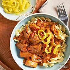 Hello healthy comfort food! Chicken thighs and sour cream give a sense of indulgence to this homey and easy recipe. The tomato-base sauce gets creamy thickness from sour cream and a bit of flour, and a kick of flavor from tangy banana peppers. Served over forkfuls of noodles, it makes a satisfying fall or winter dinner.
