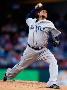 Felix Hernandez #34 of the Seattle Mariners pitches against the Texas Rangers in the bottom of the first inning at Globe Life Park in Arling...