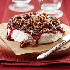 Give the people you love an elegant treat—warm brie topped with raspberry preserves and caramelized pecans.