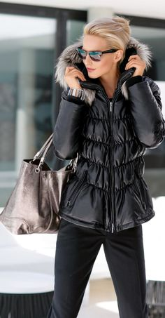 Love this black quilted down jacket and the sunglasses too!