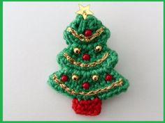 Large crochet Christmas tree brooch by MyfanwysMakes on Etsy, £4.50