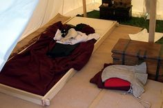 medieval camp bedding...looks like a neat alternative to a full camp bed, or a good option to have on hand for unexpected guests (NOTE: original source of this image is no longer available)
