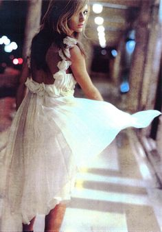 What a beautiful dress... it softly flows and the gentle movement catches everyones eye.