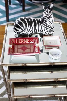 Living Room - Nesting tables topped with ashtrays and a zebra figurine