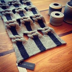 cari + carl Knot Net Shawl next to Jin Eui Kim's exquisite ceramic pieces at Snug Gallery. (Photo credit: Snug) www Knitting Designs, Knitting Stitches, Knitting Projects, Hand Knitting, Stitch Patterns, Knitting Patterns, Crochet Patterns, Knit Art, Art Textile