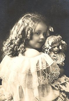 Stunning vintage photo of a little girl and her prize doll