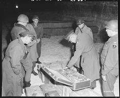 US Generals Eisenhower and Bradley examining a suitcase of German loot stored in the Merkers salt mine, Germany, 12 Apr (US National Archives) Minions, Buchenwald Concentration Camp, Monument Men, D Day, Military History, Ww2 History, World War Ii, American History, American Presidents