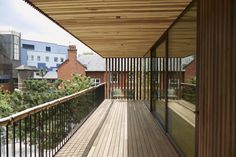 First used publicly in American tulipwood cross-laminated timber has been used to build a cancer support centre in Oldham, UK. The building features a thermo-treated American ash decking. Architecture Courtyard, Urban Architecture, Ramp Stairs, Wood Facade, Stair Handrail, Wood Magazine, Community Space, Open Concept, Cladding