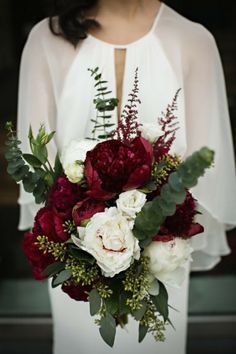 winter wedding floral bouquet of roses and greenery